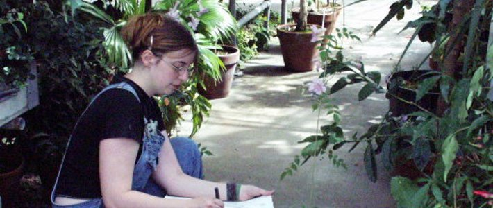 Art student sketching in the greenhouse